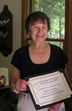 Author Betty Orlemann displays her Silver IPPY award medal